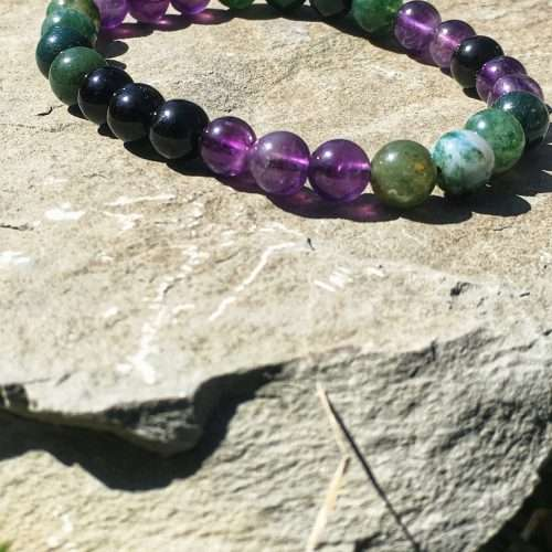Wear this beautiful Moss Agate, Amethyst, Black Onyx Reiki healing bracelet throughout your day. It will ground you, allow you to heal and release all that no longer serves you and your highest self. It will also connect you back to your heart + help you to feel protective, vibrant, energize and balance.  Repeat Affirmation with me: I am safe and well taken care of. The universe always provides me with what I need. The Grounded Awakening Love Reiki Infused Mala Bracelet is made with 8mm gemstones and strung on stretch cord, each bracelet is sized to fit most wrists.